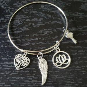 Silver adjustable charm bracelet (wing)
